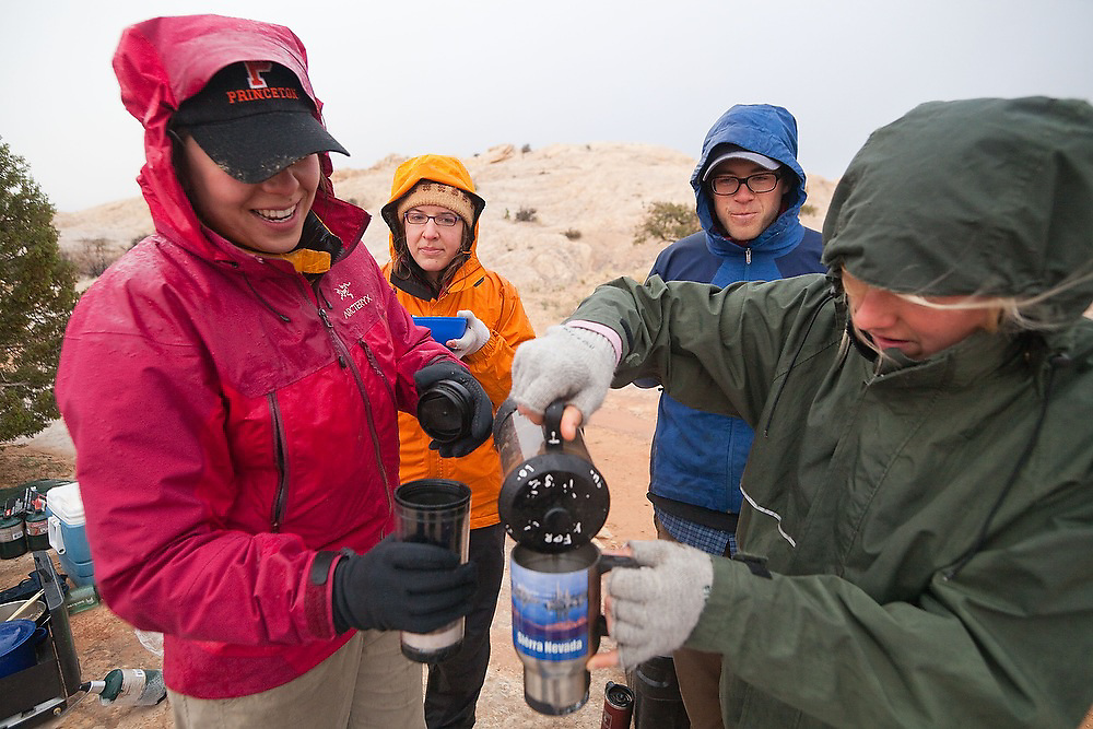 Melissa Foster pours morning coffees for other students from the University of Colorado camped near the San Rafael Swell, Utah for a geology field trip.