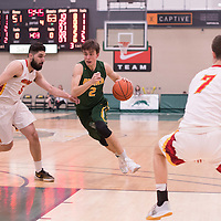 2nd year guard Samuel Hillis (2) of the Regina Cougars in action during the home game on January  28 at Centre for Kinesiology, Health and Sport. Credit: Arthur Ward/Arthur Images