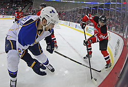 Feb 9; Newark, NJ, USA; New Jersey Devils defenseman Bryce Salvador (24) and St. Louis Blues defenseman Alex Pietrangelo (27) during the first period at the Prudential Center.