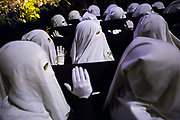 The femenine brotherhood with white capirote carrying the Virgin of Sorrows. Procession of Silence. Holy Saturday, Easter 2016 in Mataró city (Barcelona), Spain. Easter 2016, Eva Parey/4SEE.