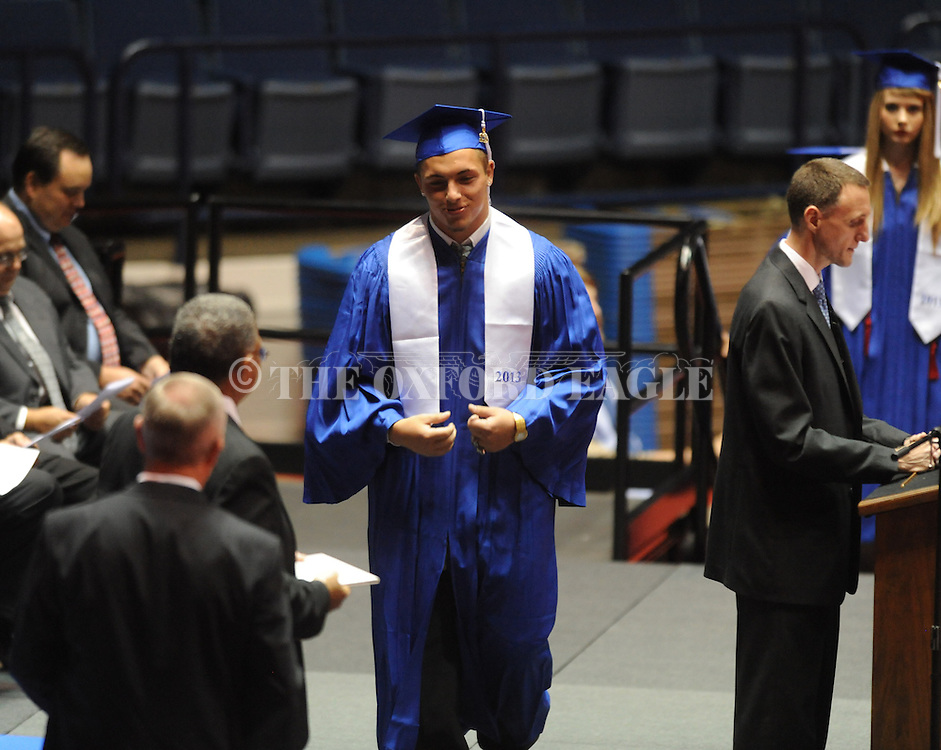 "Justin McCammon receives a diploma as Water Valley holds its graduation ceremony at the C.M. ""Tad"" Smith Coliseum in Oxford, Miss. on Thursday, May 23, 2013."
