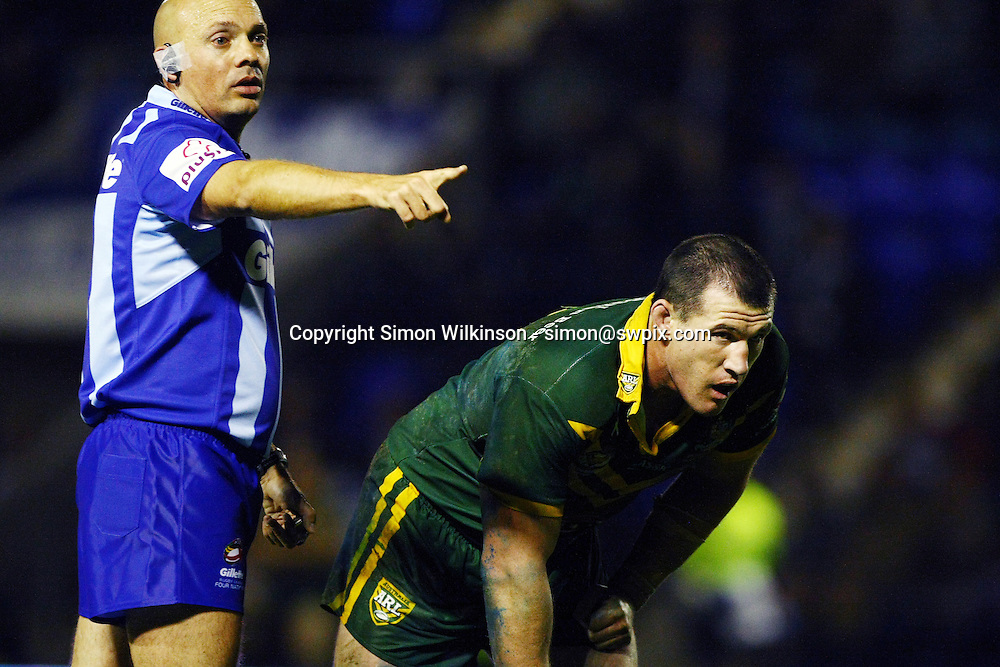 PICTURE BY VAUGHN RIDLEY/SWPIX.COM...Rugby League - Gillette 4 Nations 2011 - Australia v New Zealand - Halliwell Jones Stadium, Warrington, England - 28/10/11…Referee Phil Bentham and Australia's Paul Gallen.