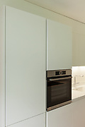 interior of a domestic kitchen, cabinets and oven