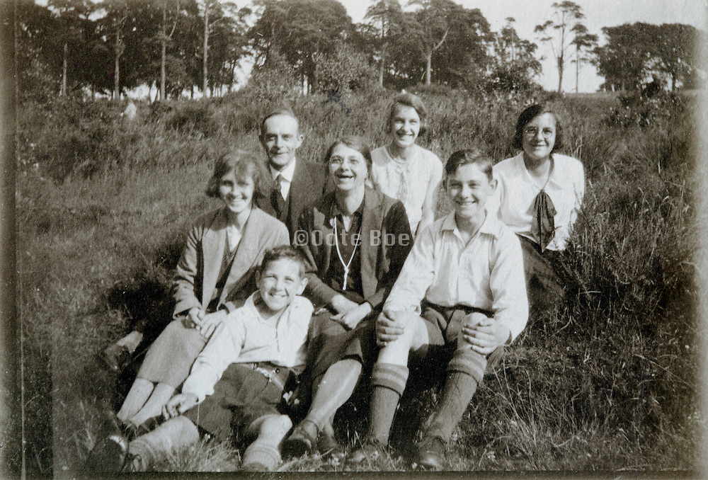 family various generation sitting and smiling 1920s