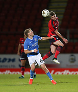 06/10/2017 - St Johnstone v Dundee - Dave Mackay testimonial at McDiarmid Park, Perth, Picture by David Young - Dundee's Jordan Piggott towers above St Johnstone's David Wotherspoon
