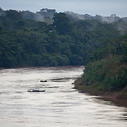 Tourist boat on the Tambopata River. Photographed at El Gato Lodge, an ecotourism initative along the Tambopata River in Peru near the community of Baltimore. El Gato, owned by the Ramirez Family, is in the buffer zone of the Tambopata National Reserve, which will be highly impacted by deforestation and development as a result of the new Interoceanica SUR highway. El Gato is one of the projects supported by Interoceanica SUR (iSUR), an organization that seeks to promote conservation efforts around the new Interoceanic Highway that streteches across Peru and Brazil.