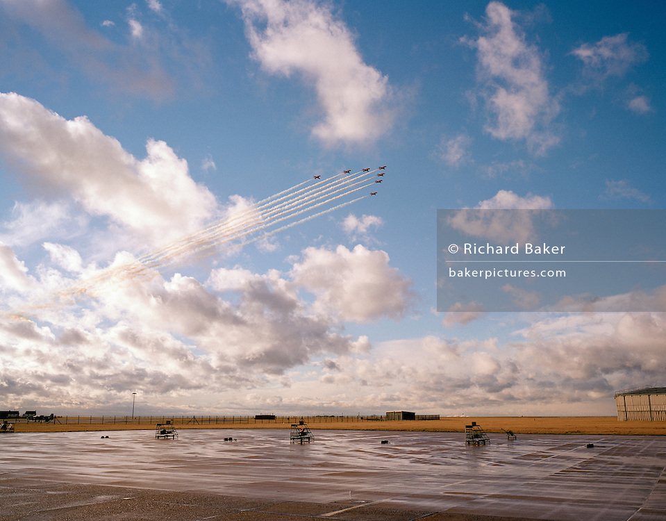 BAE System Hawks of the Red Arrows, Britain's RAF aerobatic team and wide airfield landscape.