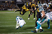 Pittsburgh Steelers rookie running back Jaylen Samuels (38) breaks a tackle attempt by Carolina Panthers rookie defensive back Rashaan Gaulden (28) as he leaps for a fourth quarter touchdown and a 52-14 Steelers lead during the NFL week 10 regular season football game against the Carolina Panthers on Thursday, Nov. 8, 2018 in Pittsburgh. The Steelers won the game 52-21. (©Paul Anthony Spinelli)