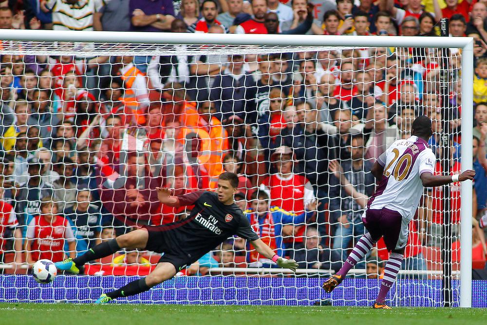 Aston Villa's Christian Benteke scores a goal past \Arsenal's Wojciech Szczesny   - Photo mandatory by-line: Mitch Gunn/JMP - Tel: Mobile: 07966 386802 17/08/2013 - SPORT - FOOTBALL - Emirates Stadium - London -  Arsenal V Aston Villa - Barclays Premier League