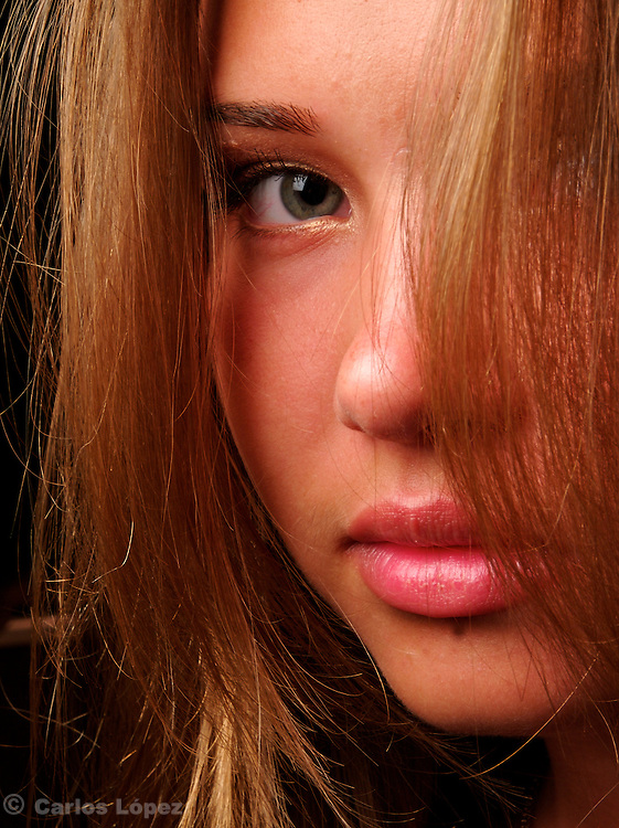 Close up portrait  of a pretty russian  girl of green eyes in a studio.