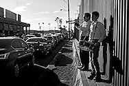 MEXICALI, MEX-NOV 19:  Musicians play for motorists waiting in line to cross into the United Stated along the U.S. Mexico border in Mexicali, Mexico on Wednesday, November 19, 2014. President Barack Obama plans to announce executive action on Immigration reform Thursday Evening.  As many as 5 Million undocumented immigrants could, on a temporary basis, be granted work permits and exempted from deporation.(Photo by Sandy Huffaker/Getty Images)