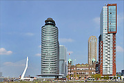 Nederland, Netherlands, Rotterdam, 2-5-2015Kop van Zuid, wilhelminakade, met de erasmusbrug en hoogbouw. Hotel New York. De Rotterdam van architect Rem Koolhaas. Oude en nieuwe architectuur.District Kop van Zuid with erasmusbridge and high-rise buildings. Building De Rotterdam from architect Rem Koolhaas. Kantoor havengebouw, port of rotterdamFOTO: FLIP FRANSSEN/ HOLLANDSE HOOGTE