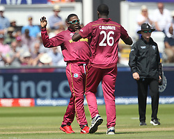 July 1, 2019 - Chester Le Street, County Durham, United Kingdom - West Indies' Sheldon Cottrell and Carlos Brathwaite high five after running out Sri Lanka's Kusal Perera during the ICC Cricket World Cup 2019 match between Sri Lanka and West Indies at Emirates Riverside, Chester le Street on Monday 1st July 2019. (Credit Image: © Mi News/NurPhoto via ZUMA Press)