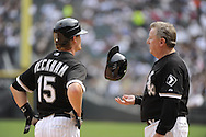 CHICAGO - JULY 10:  Gordon Beckham #15 talks to third base coach Jeff Cox #8 of the Chicago White Sox during the game against the Minnesota Twins on July 10, 2011 at U.S. Cellular Field in Chicago, Illinois.  The Twins defeated the White Sox 6-3.  (Photo by Ron Vesely)  Subject: Gordon Beckham;Jeff Cox