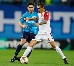 November 23, 2017 - Saint Petersburg, Russia - Yuri Zhirkov (L) of FC Zenit Saint Petersburg and Juan Felipe Ribeiro of FK Vardar vie for the ball during the UEFA Europa League Group L match between FC Zenit St. Petersburg and FK Vardar at Saint Petersburg Stadium on November 23, 2017 in Saint Petersburg, Russia. (Credit Image: © Mike Kireev/NurPhoto via ZUMA Press)