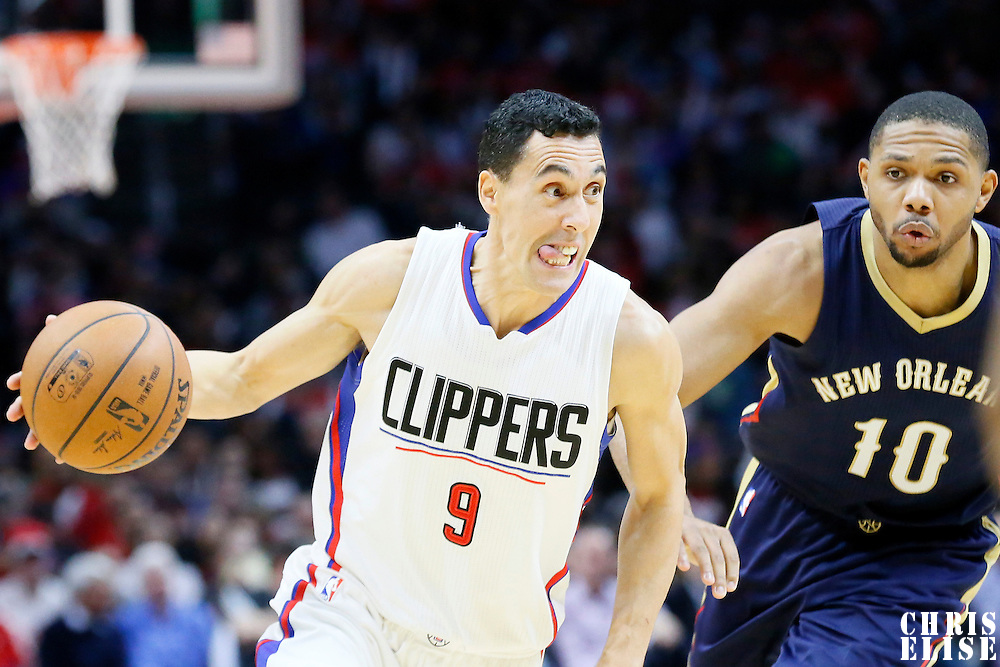 10 January 2016: Los Angeles Clippers guard Pablo Prigioni (9) drives past New Orleans Pelicans guard Eric Gordon (10) during the Los Angeles Clippers 114-111 overtime victory over the New Orleans Pelicans, at the Staples Center, Los Angeles, California, USA.