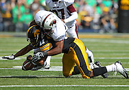 September 24, 2011: Iowa Hawkeyes wide receiver Kevonte Martin-Manley (11) can't hold onto a pass as he is hit by Louisiana Monroe Warhawks safety Isaiah Newsome (25) during the first quarter of the game between the Iowa Hawkeyes and the Louisiana Monroe Warhawks at Kinnick Stadium in Iowa City, Iowa on Saturday, September 24, 2011. Iowa defeated Louisiana Monroe 45-17.