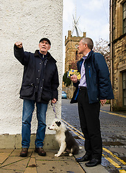 Pictured: Local Sandy Romanes and his dog Baloo took the chance to discuss local matters with Willie Rennie.<br /> <br /> Scottish Liberal Democrat leader Willie Rennie headed to a rainey Linlithgow today build on his success at the final TV debate ahead of the election on Thursday. The Lib Dems have not  ahd constituency MSP in the area in the past and hope  to change that on Thursday<br /> <br /> Ger Harley | EEm 2 May 2016