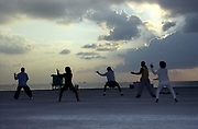 Group of people exercising on a beach, Miami, Florida, USA 2000's
