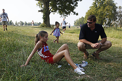 Winner of the The Henry Clay Invitational Varsity Girls Heat Lafayette runner Mia Cornette, left, talks with Kurt Netherton after the race. <br /> <br /> The Henry Clay Invitational was held Saturday, Sept. 03, 2011 in Masterson Station Park. Photo by Jonathan Palmer