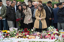 © Licensed to London News Pictures. 17/06/2016. RUTH PRICE (in beige coat) the Parliamentary Assistant for JO COX MP at the House of Commons attends a vigil and with well wishers in Parliament Square in memory of Labour party MP JO COX. She was allegedly attacked and killed by suspect 52 year old Tommy Mair close to Birstall Library near Leeds. London, UK. Photo credit: Ray Tang/LNP