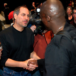 04/28/03, SAN  FRANCISCO, CALIFORNIA, UNITED STATES,  Apple CEO Steve Jobs introduces a new online music service along with new IPOD players and IMusic software in San Francisco, Calif.  Jobs shakes hands with musician Seal following the launch. --Photo by Kim Kulish