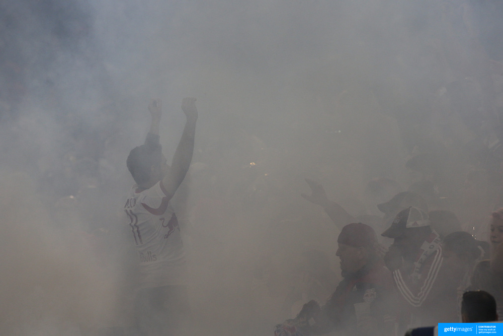 New York Red Bulls fans celebrate a goal as a smoke from a flare engulfs fans during the New York Red Bulls V Toronto FC, Major League Soccer, regular season match at Red Bull Arena, Harrison, New Jersey. USA. 14th September 2013. Photo Tim Clayton