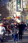 People walking along shopping street in winter clothes, Prague, Czech Republic