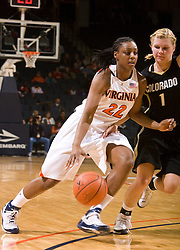 Virginia forward Monica Wright (22) dribbles past Colorado guard Alyssa Fressle (1).  The #16 ranked Virginia Cavaliers women's basketball team defeated the Colorado Buffaloes 77-43 at the John Paul Jones Arena on the Grounds of the University of Virginia in Charlottesville, VA on November 24, 2008.
