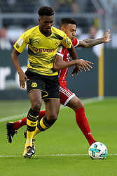 DORTMUND, Aug. 6, 2017  Dortmund's Dan-Axel Zagadou (L) vies with Bayern Munich's Corentin Tolisso during the 2017 German Super Cup match between Bayern Munich and Borussia Dortmund in Dortmund, Germany, on Aug. 5, 2017. Bayern Munich won 7-6 after penalty shootout and got the 2017 German Super Cup trophy. (Credit Image: © Joachim Bywaletz/Xinhua via ZUMA Wire)