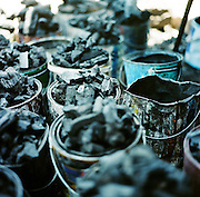 NAIROBI, KENYA – MARCH 11, 2010: Colorful detail of charcoal sold on the streets in Kenya.