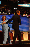 Senator John Edwards walks on to the stage to accept the Vice Presidential nomination as his wife Elizabeth leaves the stage after introducing him at The Democratic National Committee Convention at the Fleet Center in Boston, MA. 7/28/2004