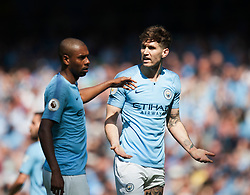 John Stones (R) and Fernandinho of Manchester City argue - Mandatory by-line: Jack Phillips/JMP - 20/04/2019 - FOOTBALL - Etihad Stadium - Manchester, England - Manchester City v Tottenham Hotspur - English Premier League