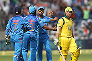 Ravindra Jadeja celebrates the wicket of Phillip Hughes of Australia as he departs during the first Star Sports Series One Day International (ODI) between India and Australia held at the Subrata Roy Sahara Stadium, Pune on the 13th October 2013<br /> <br /> Photo by Ron Gaunt - BCCI - SPORTZPICS  <br /> <br /> Use of this image is subject to the terms and conditions as outlined by the BCCI. These terms can be found by following this link:<br /> <br /> http://sportzpics.photoshelter.com/gallery/BCCI-Image-terms-and-conditions/G00004IIt7eWyCv4/C0000ubZaQCkIRgQ