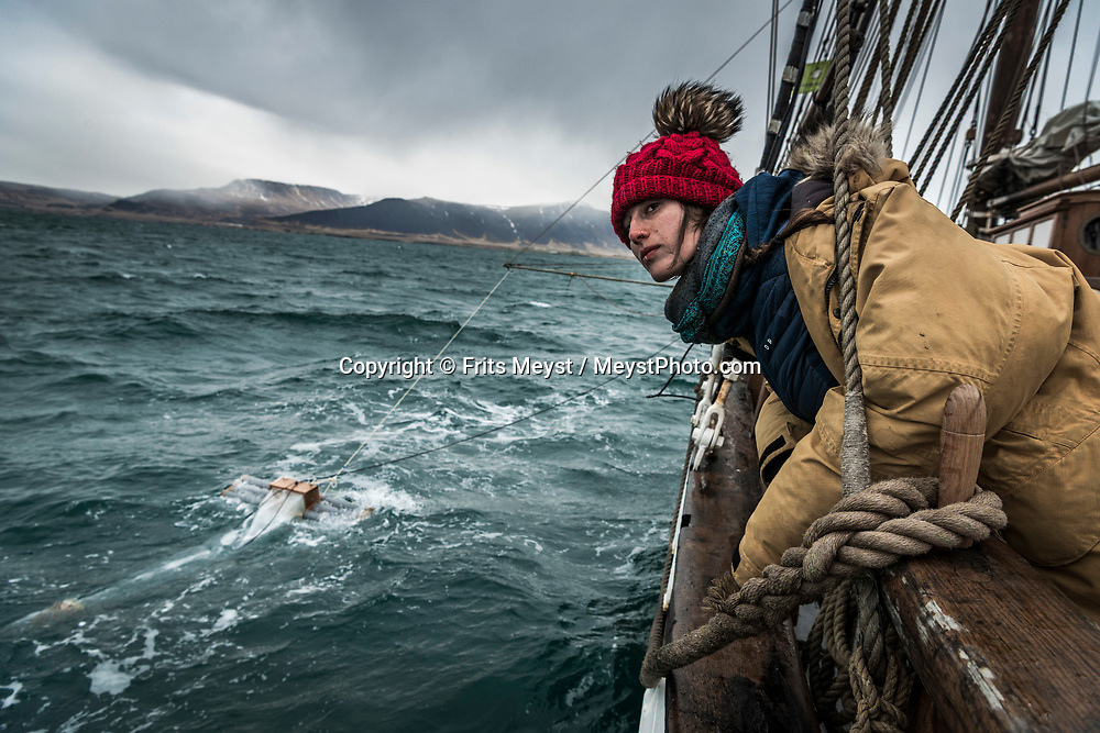 Iceland, April 2019. Trawling for microplastics with the so called Manta Trawl. With this device the scientists van trap plastic and count particles in the water.  Scientists, storytellers and industrial designers work together during the Ocean Missions Iceland scientific sailing expedition aboard Schooner Opal.  The organisation wants to inspire people to take direct action towards ocean conservation, by combining science and education with exploration and adventure. Photo by Frits Meyst / Meystphoto.com