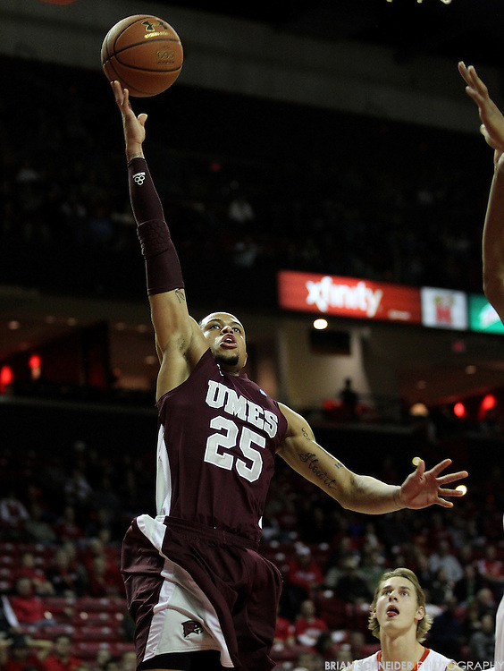 December 5 2012; College Park, USA; Maryland Eastern Shore Hawks forward Donald Williams (25) attempts a layup against the Maryland Terrapins in the first half at the Comcast Center in College Park, MD. Mandatory Credit: Brian Schneider-www.ebrianschneider.com