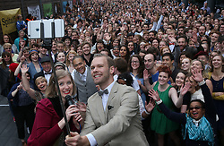© Licensed to London News Pictures. 11/10/2015. London, UK. Hosts Robyn Larsen and Benjamin Cook take a group selfie as  volunteers rehearse an attempt to break the world record for the largest number of people dancing the Charleston at Spitalfields. Photo credit: Peter Macdiarmid/LNP