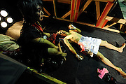 Two wrestlers recuperate after their bouts at Doglegs, an event for wrestlers with physical and mental handicaps in Tokyo, Japan.