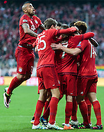 Xabi Alonso of Bayern Munich celebrates scoring their first goal with team mates during the UEFA Champions League match at Allianz Arena, Munich<br /> Picture by EXPA Pictures/Focus Images Ltd 07814482222<br /> 03/05/2016<br /> ***UK &amp; IRELAND ONLY***<br /> EXPA-FEI-160503-5017.jpg