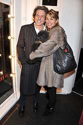 STEPHEN & ASSIA WEBSTER at a Private View of Bruno Bisang 30 Years of Polaroids held at The Little Black Gallery, 13A Park Walk, London SW10 on 15th January 2013.