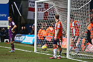 Picture by David Horn/Focus Images Ltd +44 7545 970036.16/02/2013.Luton Town players look dejected as Rob Hulse (not pictured) scores his side's second goal to make it 2-0 during the The FA Cup match at Kenilworth Road, Luton.