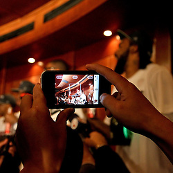 Jun 21, 2012; Miami, FL, USA; A reporter films the Miami Heat locker room celebration after the Heat defeated the Oklahoma City Thunder to win the 2012 NBA championship at the American Airlines Arena. Miami won 121-106. Mandatory Credit: Derick E. Hingle-US PRESSWIRE