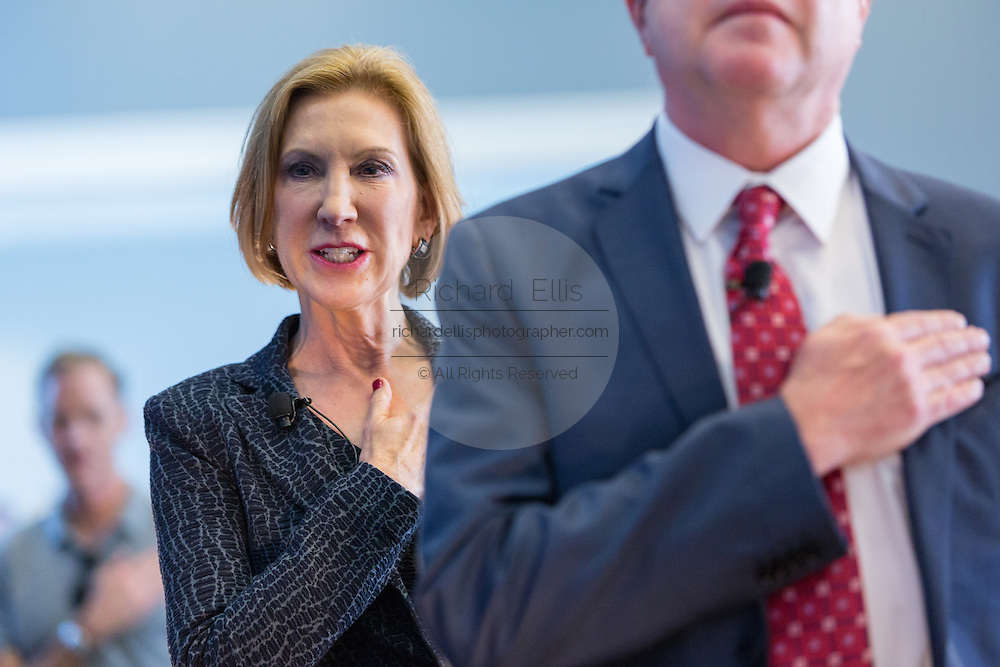 Former CEO and GOP presidential hopeful Carly Fiorina stands for the pledge to the flag at the National Security Forum with the Americans for Peace, Prosperity and Security at the Citadel Military College September 22, 2015 in Charleston, South Carolina.