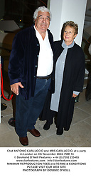 Chef ANTONIO CARLUCCIO and MRS CARLUCCIO, at a party in London on 4th November 2003.POE 13