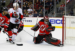 Jan 4, 2008; Newark, NJ, USA; New Jersey Devils goalie Scott Clemmensen (35) makes a glove save during the first period of the Devils game against the Ottawa Senators at the Prudential Center.