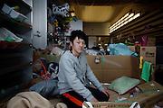 Koriyama, April 25 2011 - <br /> (eng) Ishii Kazuki, 17, comes from Tomioka. He chose to stay in the area in order to keep studying at the same school and do not leave his friends. His father works as a volunteer in the shelter while the rest of his family took refuge in another prefecture.<br /> Before the school starts again in Koriyama, he  reads comics, does his homework or check internet onhis mobile phone.<br /> Fo him, the nuclear power plant is too important for the economy in this area, so we can't turn it down.<br /> (fr) Ishii Kazuki, 17 ans, vient du village de Tomioka. Il n'a pas souhaite suivre sa mere et ses freres et soeur dans un autre prefecture, pour pouvoir terminer ses etudes dans la meme ecole et rester avec ses amis. Son pere travaille comme volontaire dans le centre de refugies, mais Ishii ne le voit presque jamais pour ne pas le deranger. Avant la reprise des cours, dans son ecole delocalisee a Koriyama, il passe le temps en naviguant sur internet ou en lisant des mangas. Pour lui, le nucleaire a apporte beaucoup d'emplois dans la region, on ne peut pas le supprimer. Mais il espere que d'autres sources d'energie viendront remplacer les centrales dans le futur.