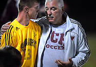 29 Sept. 2011 -- SPANISH LAKE, Mo. -- Trinity Catholic High School soccer coach Vince Drake talks with Titan soccer player Todd Willis (13) before sending him into their game with John F. Kennedy Catholic High School at Trinity in Spanish Lake, Mo. Thursday, Sept. 29, 2011. During the game Trinity players wore replica jerseys from Rosary High School, one of the predecessor schools to Trinity, which was formed in 2003. Photo © copyright 2011 Sid Hastings.
