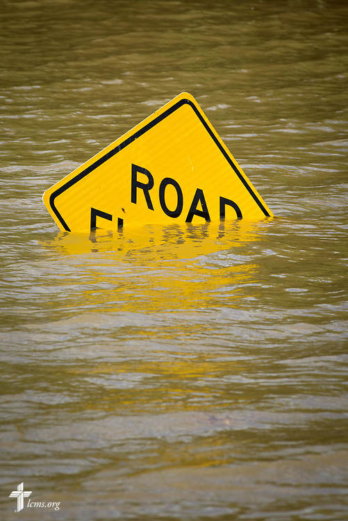 A flooded road sign is swallowed by flood waters on Tuesday, May 2, 2017, near the Meramec River in south St. Louis County.  LCMS Communications/Erik M. Lunsford