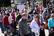 Families line up to receive prizes following the 21st Annual Easter Egg Hunt at Winnequah Park in Monona, WI on Saturday, April 20, 2019.