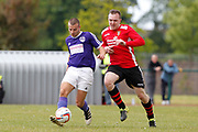 City of Liverpool's (purple) Joseph Camozzie and   Litherland's Stephen King (Red) during the North West Counties League Play Off Final match between Litherland REMYCA  and City of Liverpool FC at Litherland Sports Park, Litherland, United Kingdom on 13 May 2017. Photo by Craig Galloway.